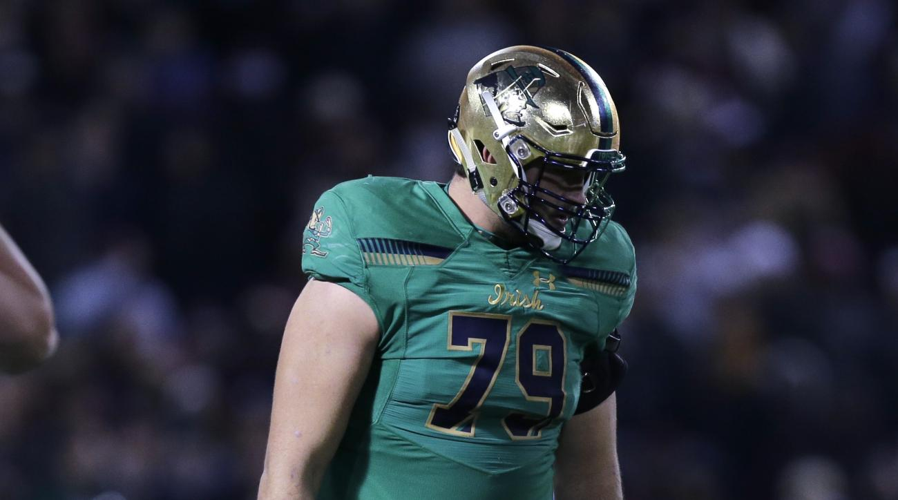 Notre Dame offensive lineman Steve Elmer (79) during the fourth quarter of the Shamrock Series NCAA college football game at Fenway Park, home of the Boston Red Sox, in Boston Saturday, Nov. 21, 2015.  Notre Dame beat Boston College 19-16. (AP Photo/Charl