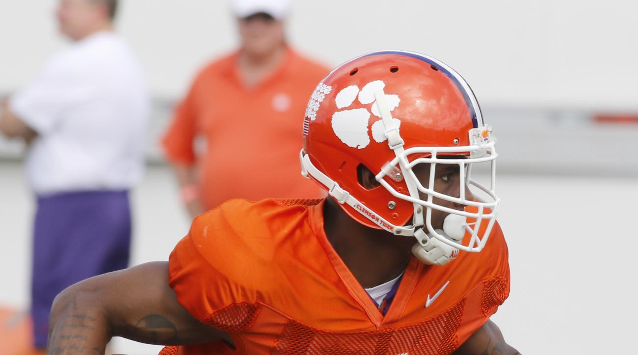 Clemson wide receiver Germone Hopper returns the ball during NCAA college football practice Monday, Dec. 28, 2015, in Davie, Fla. Clemson is scheduled to play Oklahoma in the Orange Bowl on New Year's Eve. (AP Photo/Joe Skipper)