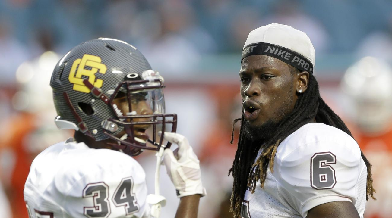 Bethune Cookman defensive back Marquis Drayton (6) and Ty're Simmons (34) talk during an NCAA college football game against Miami, Saturday, Sept. 5, 2015, in Miami Gardens, Fla. (AP Photo/Alan Diaz)