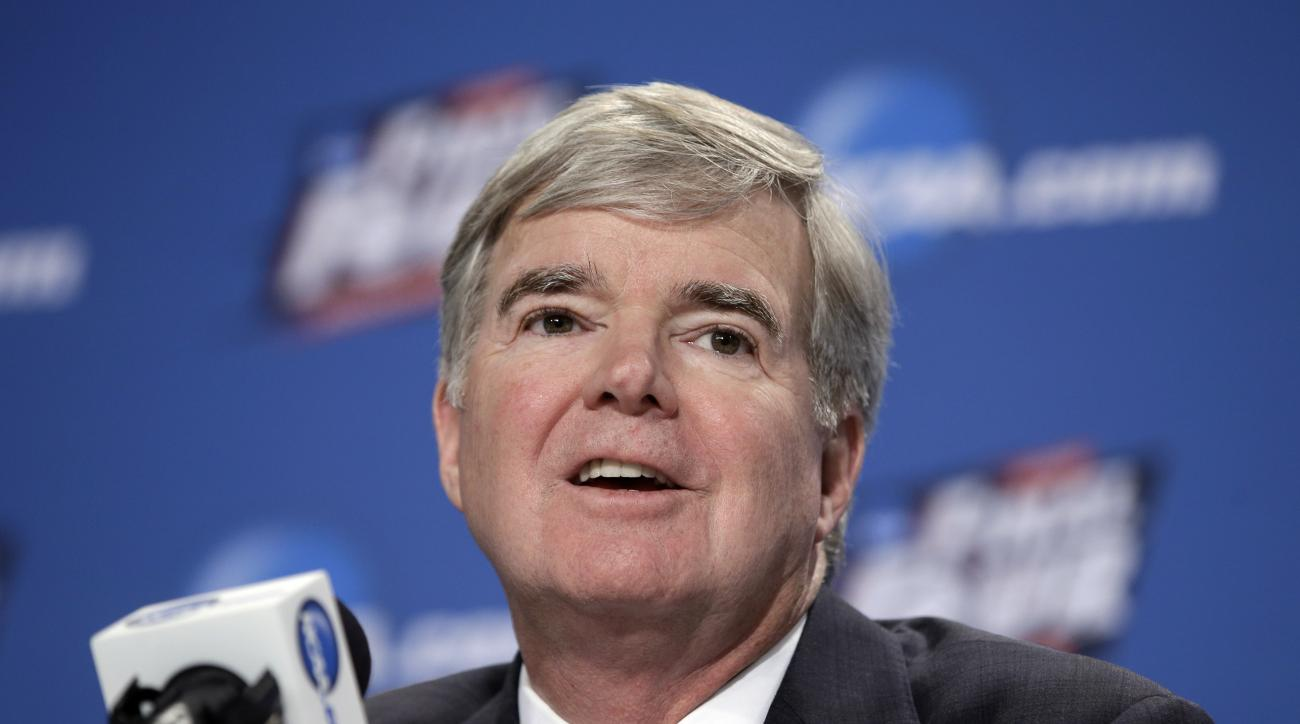 FILE - In this April 2, 2015, file photo, NCAA President Mark Emmert answers questions during a news conference at the Final Four college basketball tournament in Indianapolis. Emmert believes mid- and lower-level members are gradually adjusting to Power