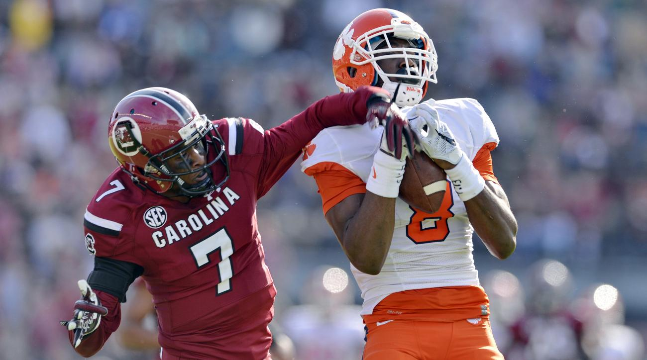 Clemson's Deon Cain pulls in a 55-yard pass for a touchdown while defended by South Carolina's Al Harris Jr.during the first half of an NCAA college football game Saturday,  Nov. 28, 2015,  in Columbia,  S.C. (AP Photo/Richard Shiro)