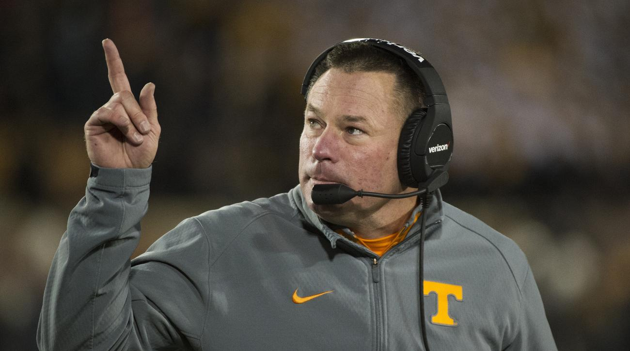FILE - In this Nov. 21, 2015 file photo, Tennessee head coach Butch Jones points to the scoreboard during the first quarter of an NCAA college football game against Missouri in Columbia, Mo. Tennessee head coaches will hold a rare joint press conference T