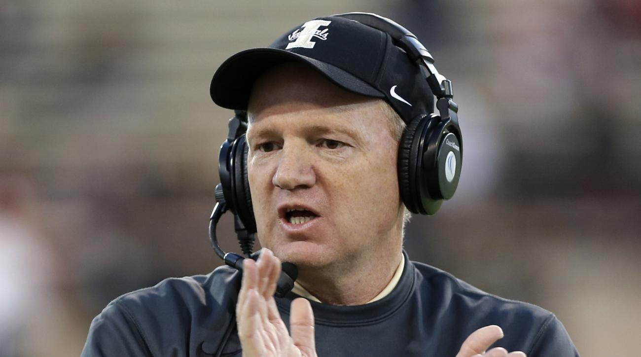 Idaho head coach Paul Petrino applauds during the first half of an NCAA college football game against New Mexico State in Las Cruces, N.M., Saturday, Oct. 31, 2015. (AP Photo/Andres Leighton)