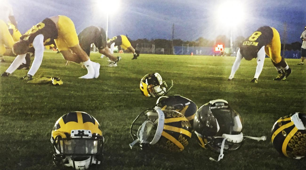 Michigan players stretch after practice at the IMG Academy, Tuesday, March 1, 2016 in Bradenton, Fla. The Wolverines are use spring break for spring practice. Some college sports leaders and criticized coach Jim Harbaugh's decision to make his players pra