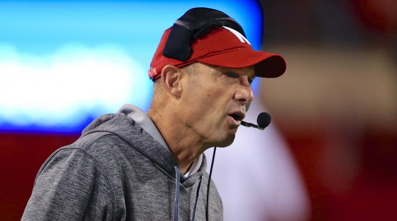 FILE - In this Sept. 12, 2015, file photo, Nebraska coach Mike Riley talks on his headset during the team's NCAA college football game against South Alabama in Lincoln, Neb. The anxiety Nebraska players felt a year ago at this time has been replaced by an