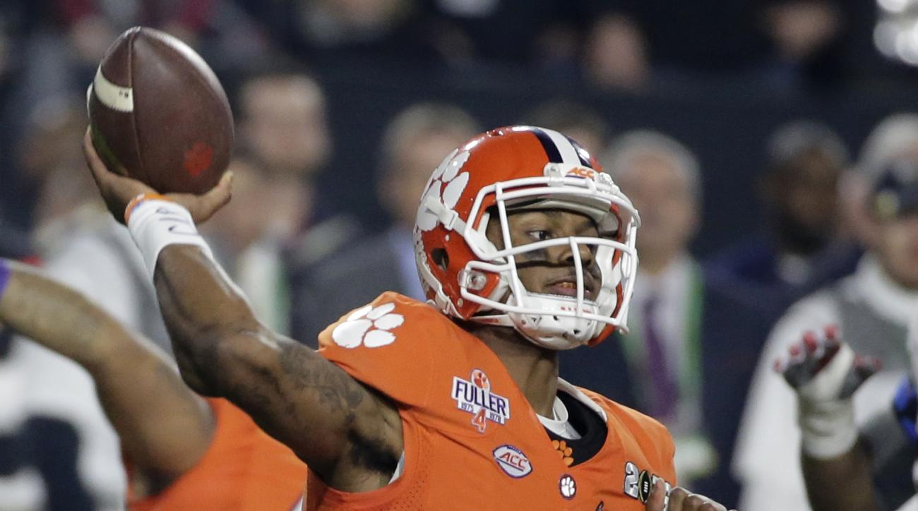 FILE - In this Jan. 11, 2016, file photo, Clemson quarterback Deshaun Watson throws during the first half of the NCAA college football playoff championship game against Alabama, in Glendale, Ariz. The buzz has already begun: Clemson's offense led by quart