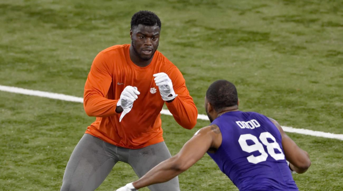 Shaq Lawson, back, and Kevin Dodd run drills at Clemson's NFL football Pro Day Thursday, March 10, 2016, in Clemson, S.C.  (AP Photo/Richard Shiro)
