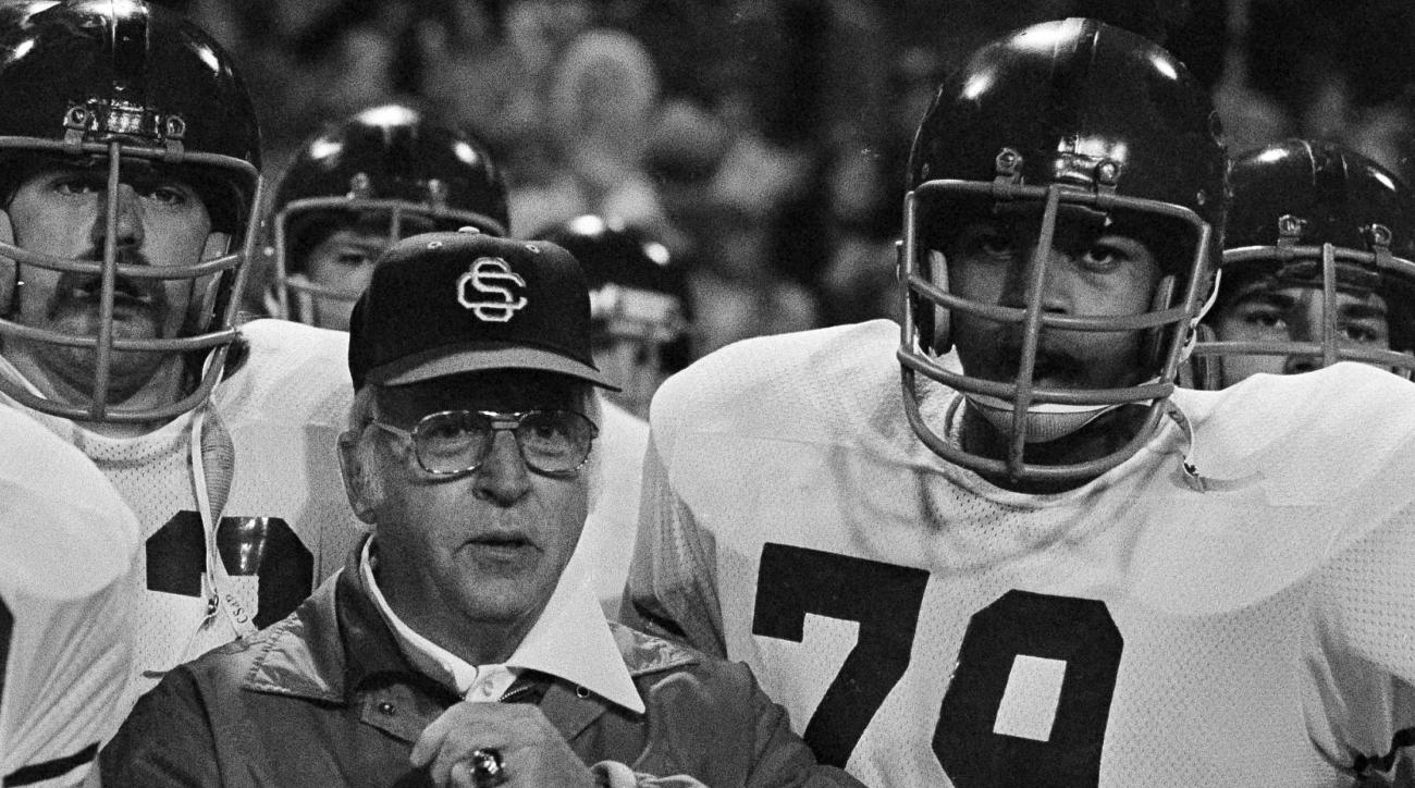 FILE - In this Dec. 22, 1975, file photo, University of Southern California head coach John McKay is shown on the sideline with lineman Gary Jeter (79) during the Liberty Bowl college football game against Texas A&M, in Memphis, Tenn. Gary Jeter, a defens