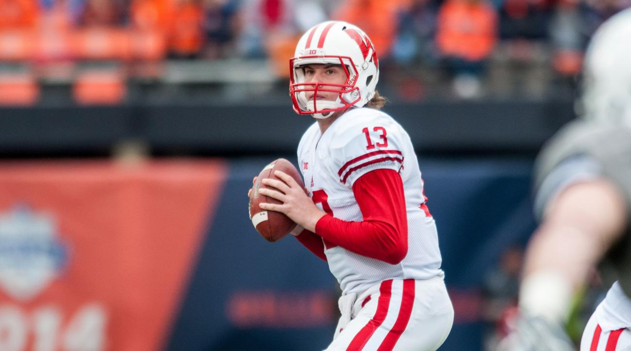 Wisconsin quarterback Bart Houston (13) looks for a receiver during the second quarter of an NCAA college football game against Illinois, Saturday, Oct. 24, 2015, in Champaign, Ill. (AP Photo/Bradley Leeb)