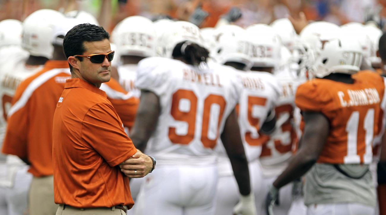 FILE - In this April 3, 2011, file photo, then-Texas' defensive coordinator Manny Diaz looks on before the Texas Orange and White spring football scrimmage in Austin, Texas. The Miami Hurricanes' new defensive coordinator understands the enormity of the j