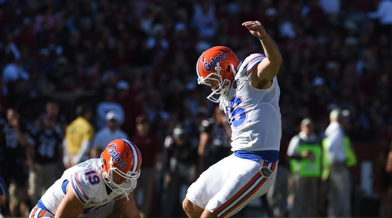 Florida's Austin Hardin (16) kicks a field goal during the second half of an NCAA college football game, Saturday, Nov. 14, 2015, in Columbia, S.C. Florida won 24-14. (AP Photo/Rainier Ehrhardt)