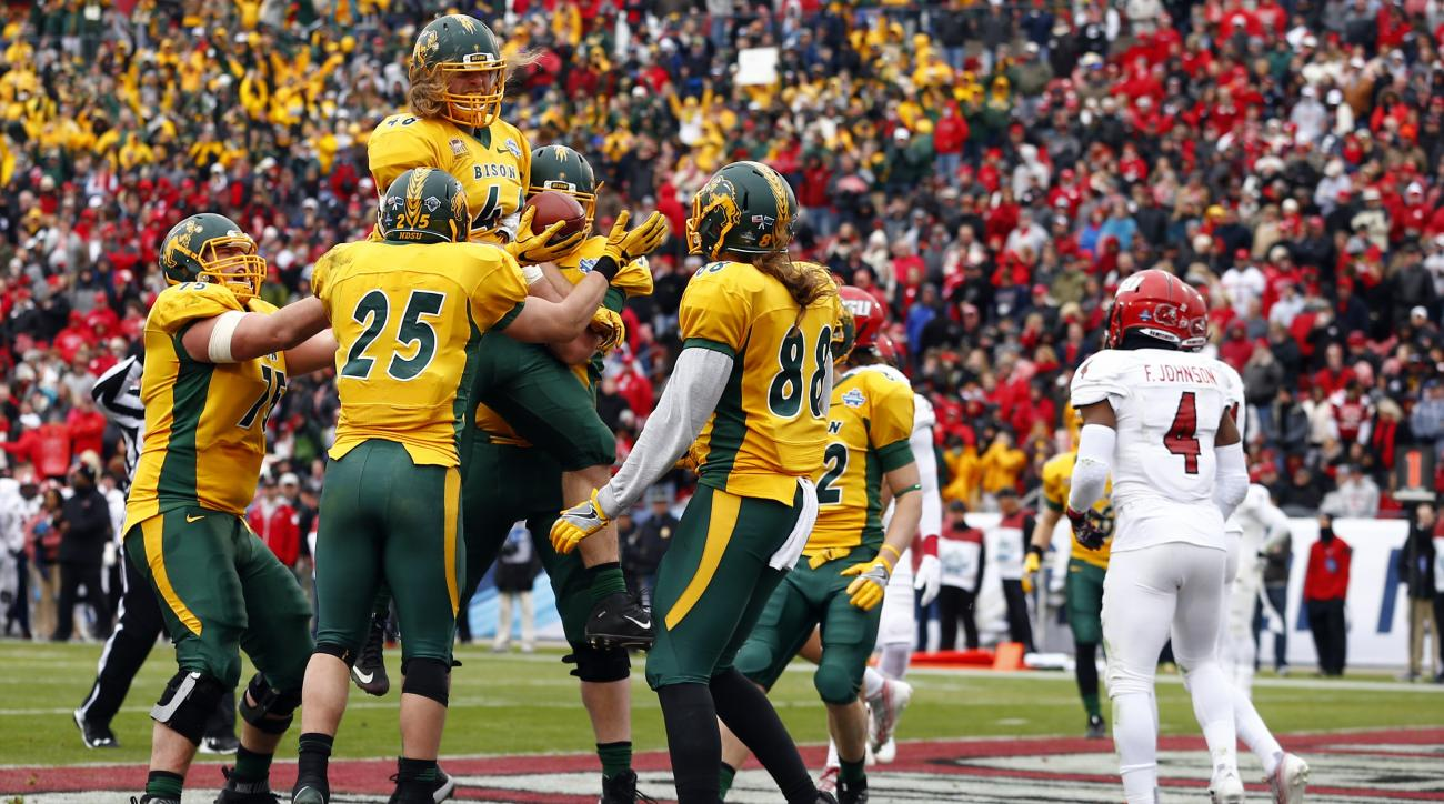 North Dakota State celebrates after fullback Andrew Bonnet (46) scored against Jacksonville State during the first half of the FCS championship NCAA college football game, Saturday, Jan. 9, 2016, in Frisco, Texas.  (AP Photo/Mike Stone)