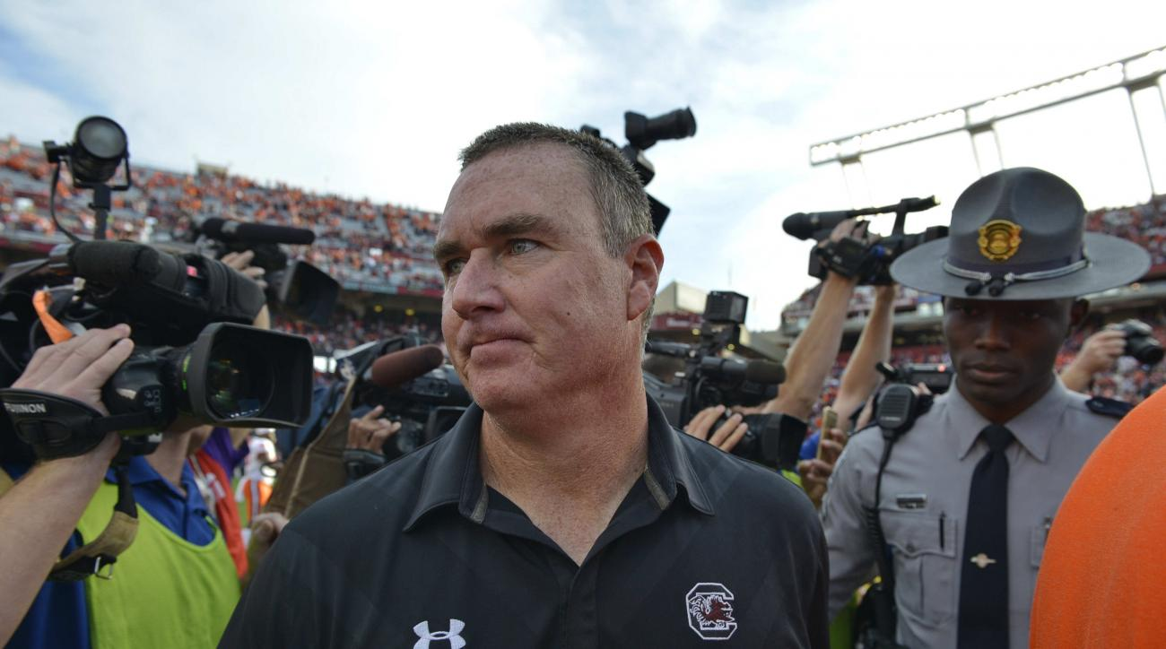 FILE -In this Saturday, Nov. 28, 2015 file photo, South Carolina interim head coach Shawn Elliott leaves the field after an NCAA college football game against Clemson, in Columbia, S.C.  Elliott wasn't sure what he'd do next after his half-season stint as