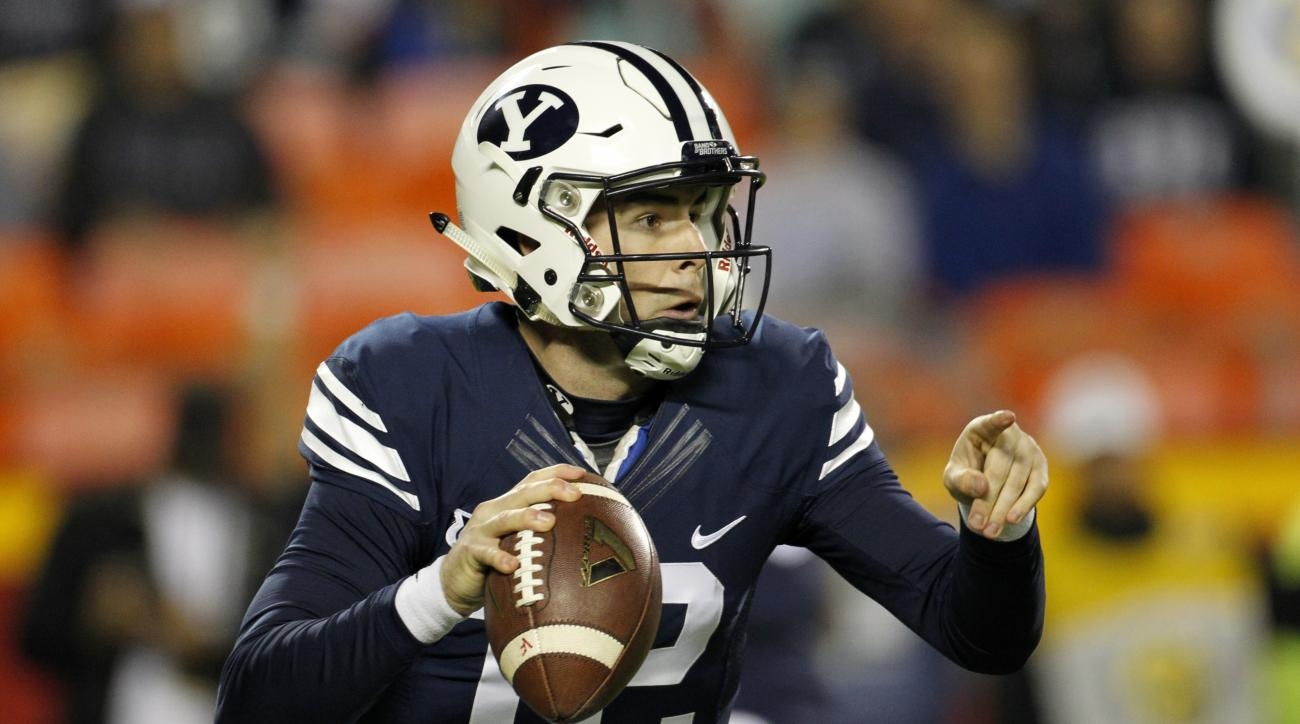BYU quarterback Tanner Mangum (12) looks downfield in the first half of a college football game against Missouri at Arrowhead Stadium, Saturday, Nov. 14, 2015, in Kansas City, Mo. (AP Photo/Colin E. Braley)