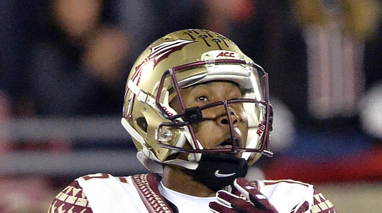 FILE - In this Oct. 30, 2014, file photo, Florida State's Travis Rudolph makes a reception during the second half of an NCAA college football game against Louisville in Louisville, Ky. As Florida State's 2016 spring practices hit the midway point, Rudolph