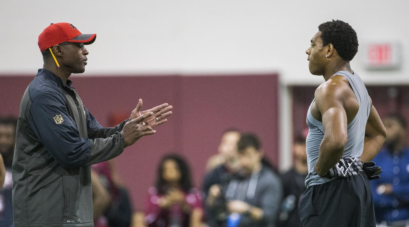 Jalen Ramsey, right, receives direction from a Tampa Bay Buccaneers representative during Florida State's NFL football pro day in Tallahassee, Fla., Tuesday, March 29, 2016. (AP Photo/Mark Wallheiser)