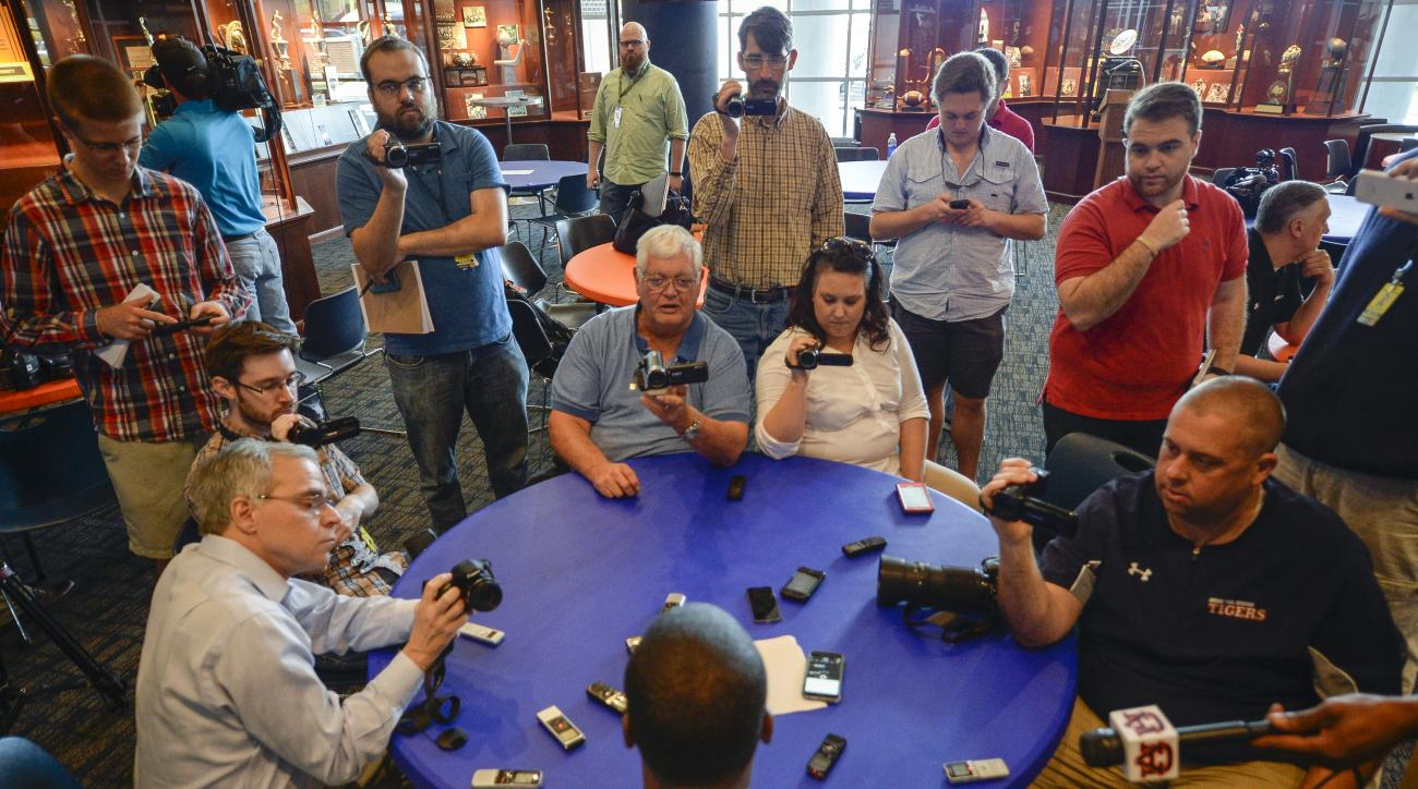 Reporters interview Auburn linebackers coach Travis Williams Tuesday, March 29, 2016, during a press conference at the Auburn Athletic Complex in Auburn, Ala.   (Julie Bennett /AL.com via AP) MAGS OUT; MANDATORY CREDIT