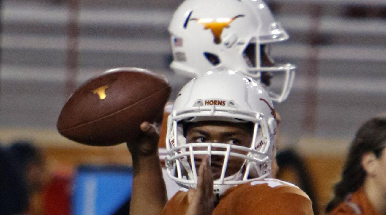 Texas quarterback Jerrod Heard (13) warms up for an NCAA college football game against Texas Tech, Thursday, Nov. 26, 2015, in Austin, Texas. (AP Photo/Michael Thomas)