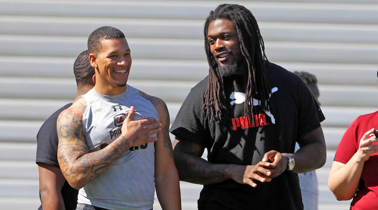 Running back Brandon Wilds (22) laughs with former Gamecock standout Jadeveon Clowney during South Carolina's NFL football Pro Day, Wednesday, March 30, 2016, at Williams-Brice Stadium in Columiba, S.C. (Gerry Melendez/The State via AP)