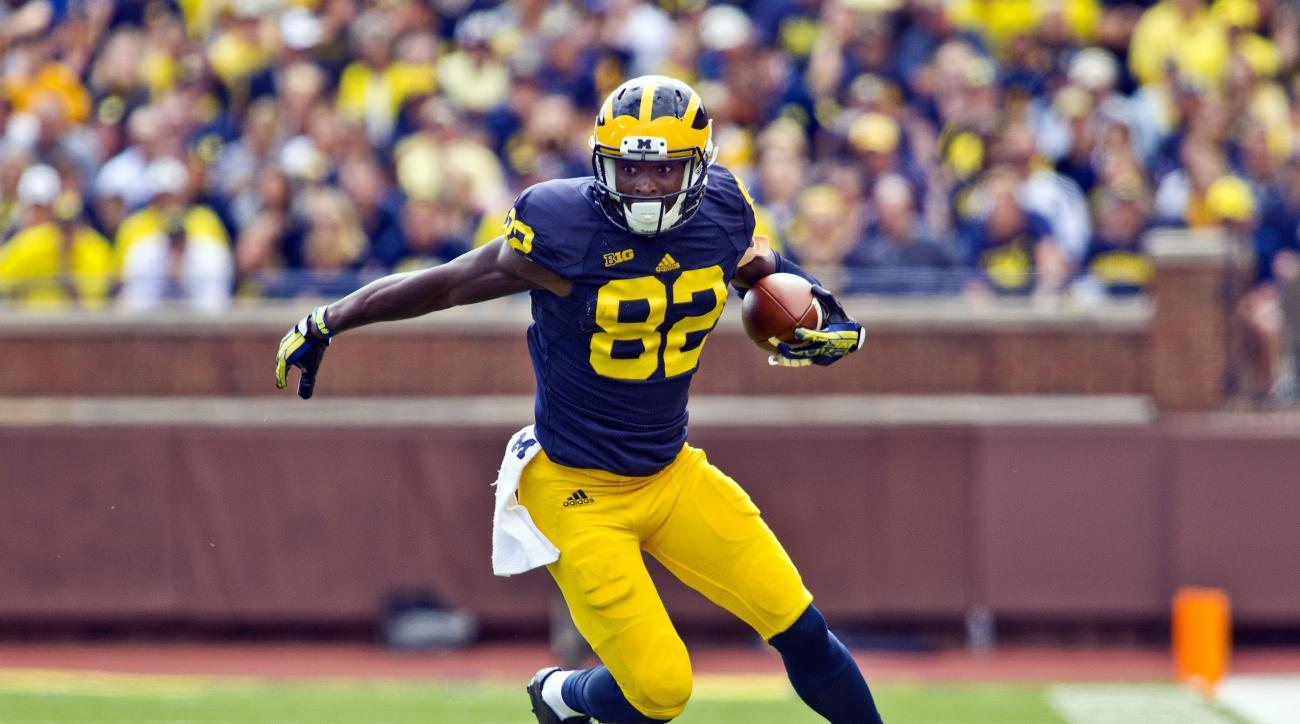 FILE - In this Sept. 19, 2015, file photo, Michigan wide receiver Amara Darboh (82) rushes in the third quarter of an NCAA college football game against UNLV in Ann Arbor, Mich. Whomever coach Jim Harbaugh picks  to be under center will be able to lean on