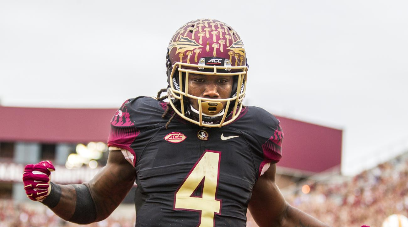 FILE - In this Saturday, Nov. 21, 2015, file photo, Florida State running back Dalvin Cook celebrates a touchdown run in the first half of an NCAA college football game against Chattanooga in Tallahassee, Fla. The Florida State-Florida rivalry is national