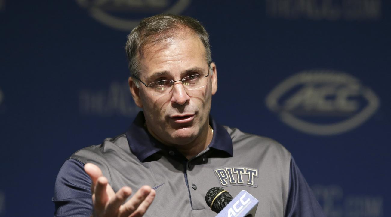 FILE - In this July 21, 2015, file phto, Pittsburgh coach Pat Narduzzi responds to questions during the Atlantic Coast Conference NCAA football kickoff in Pinehurst, N.C. In January 2007, mega-recruit Jimmy Clausen enrolled at Notre Dame, bypassing a fina