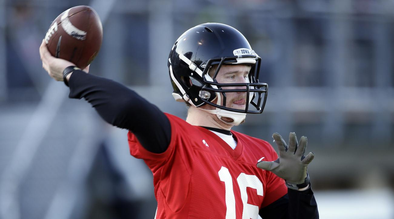 Iowa quarterback C.J. Beathard throws a pass during a college football practice, Friday, April 8, 2016, in West Des Moines, Iowa. (AP Photo/Charlie Neibergall)