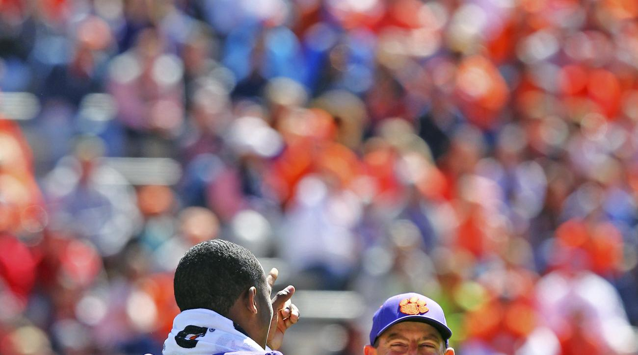 Clemson's Deshaun Watson (4) and coach Dabo Swinney laugh during the NCAA college football team's spring game Saturday, April 9, 2016, at Memorial Stadium in Clemson, S.C. (Ken Ruinard/Anderson Independent-Mail via AP)