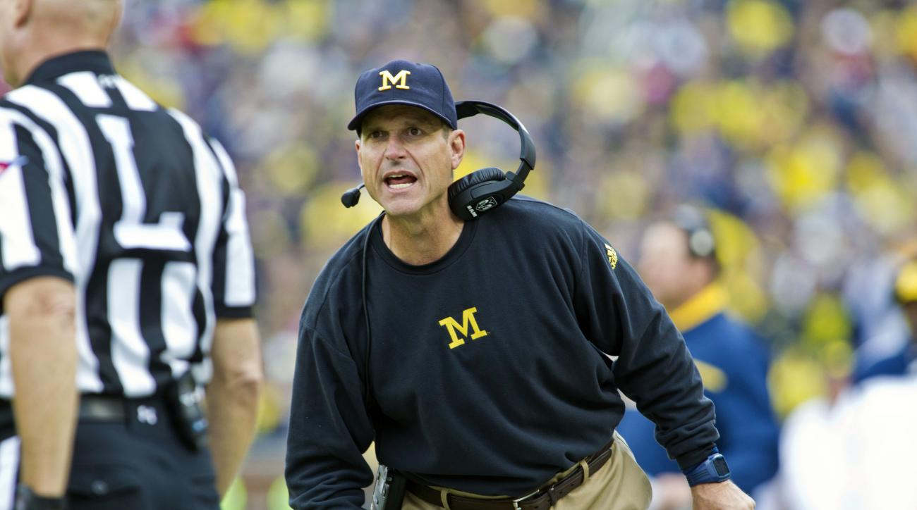 FILE - In this Saturday, Sept. 12, 2015 file photo, Michigan head coach Jim Harbaugh tries to get the attention of a line judge on the sideline in the third quarter of an NCAA college football game against Oregon State in Ann Arbor, Mich. Jim Harbaugh has