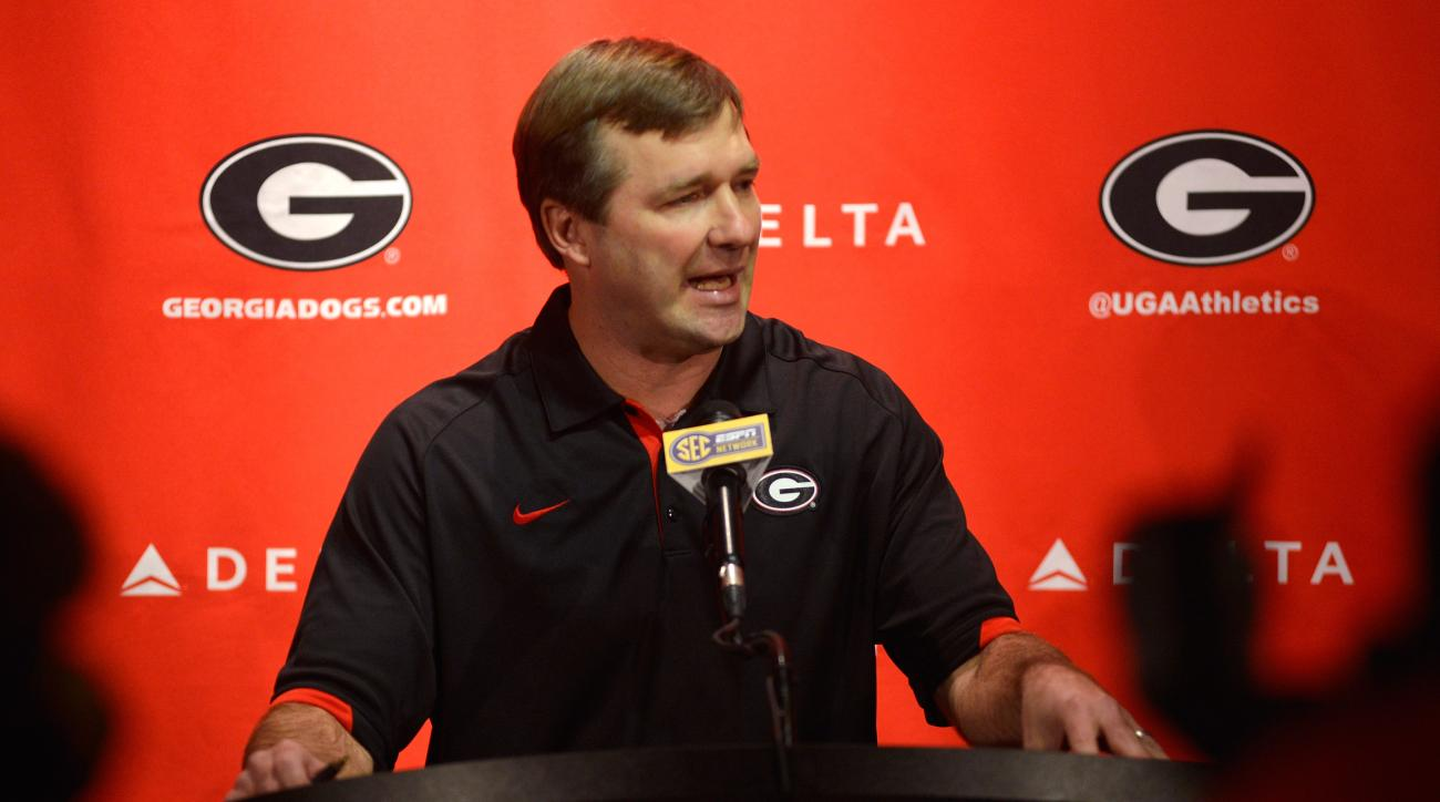FILE - In this Jan. 13, 2016 file photo, University of Georgia NCAA college football head coach Kirby Smart speaks during a press conference in Athens, Ga. Georgia coach Kirby Smart says he is disappointed there has been no separation in the quarterback c