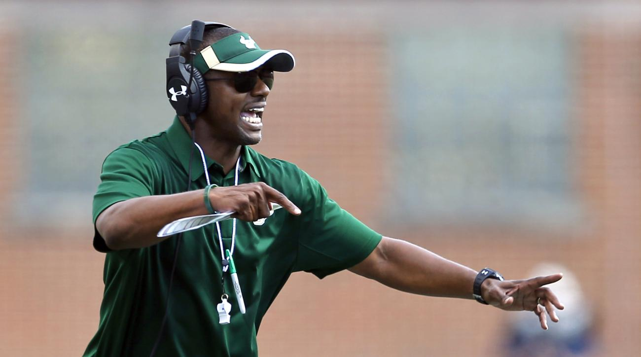 FILE - In this Sept. 19, 2015, file photo, South Florida coach Willie Taggart directs his players during an NCAA college football game against Maryland in College Park, Md. After hitting rock bottom at Maryland last year, USF went 7-3, played like one of