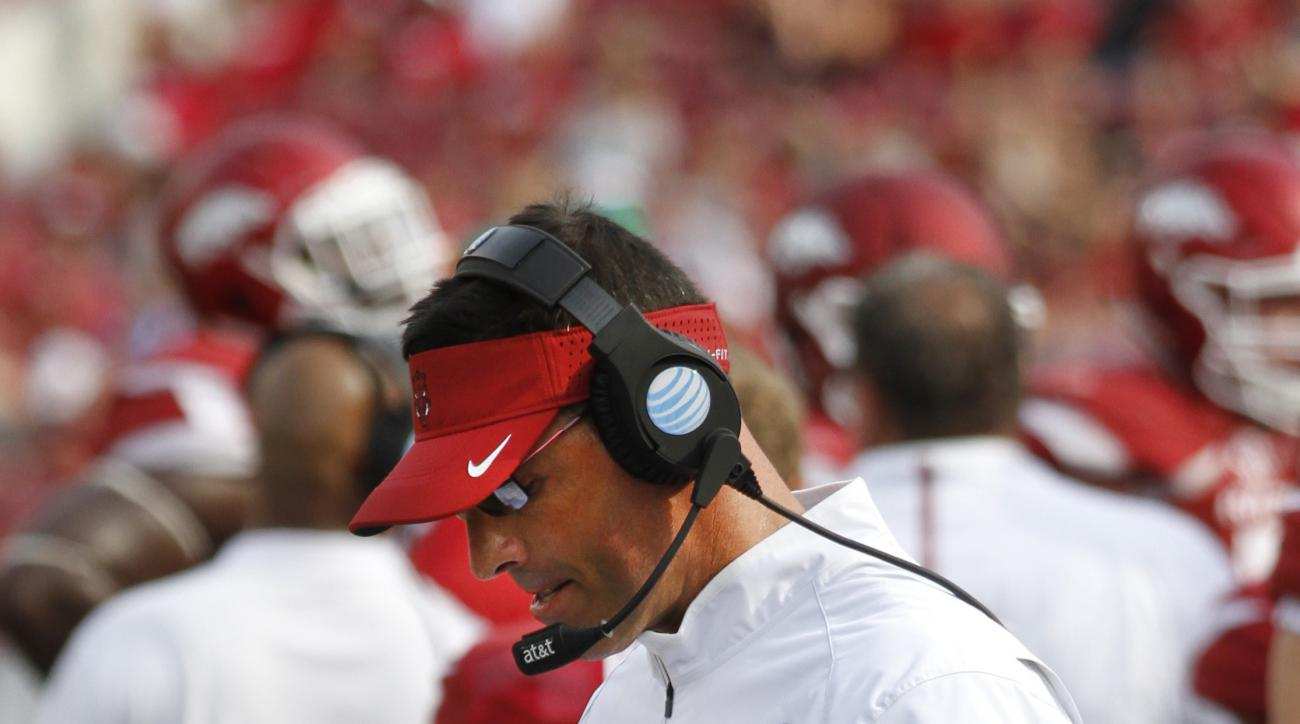 FILE - In this Sept. 5, 2015, file photo, Arkansas offensive coordinator Dan Enos walks the sideline during a timeout in the second half of an NCAA college football game against  UTEP in Fayetteville, Ark. A year after Dan Enos left a head coaching job at