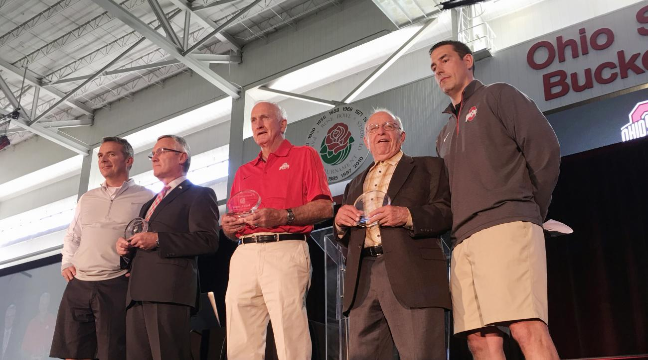 Ohio State football coach Urban Meyer, left, is joined by former Ohio State football coaches, from left, Jim Tressel, John Cooper, Earl Bruce and Luke Fickell at a high school coaches clinic in Columbus, Ohio, Friday, April 15, 2016. (AP Photo/Mitch Stacy