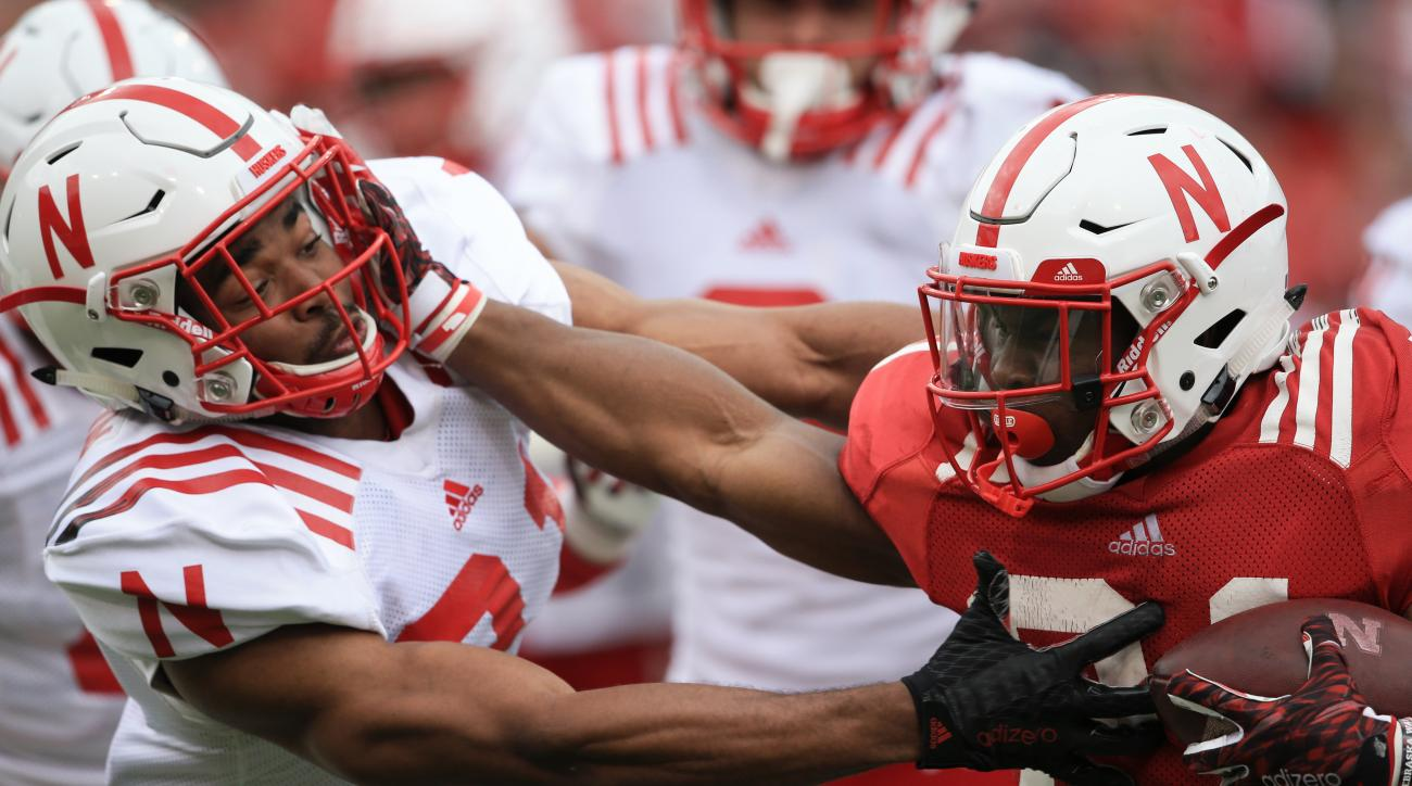 Nebraska red team running back Mikale Wilbon, right, is tackled by white team defensive back Charles Jackson, left, during the Red White spring NCAA college football in Lincoln, Neb., Saturday, April 16, 2016. (AP Photo/Nati Harnik)