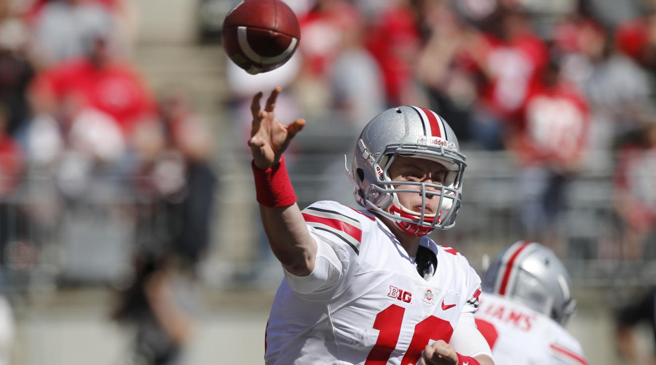 Ohio State quarterback Joe Burrow throws a pass during Ohio State's NCAA college football spring game Saturday, April 16, 2016, in Columbus, Ohio. (AP Photo/Jay LaPrete)