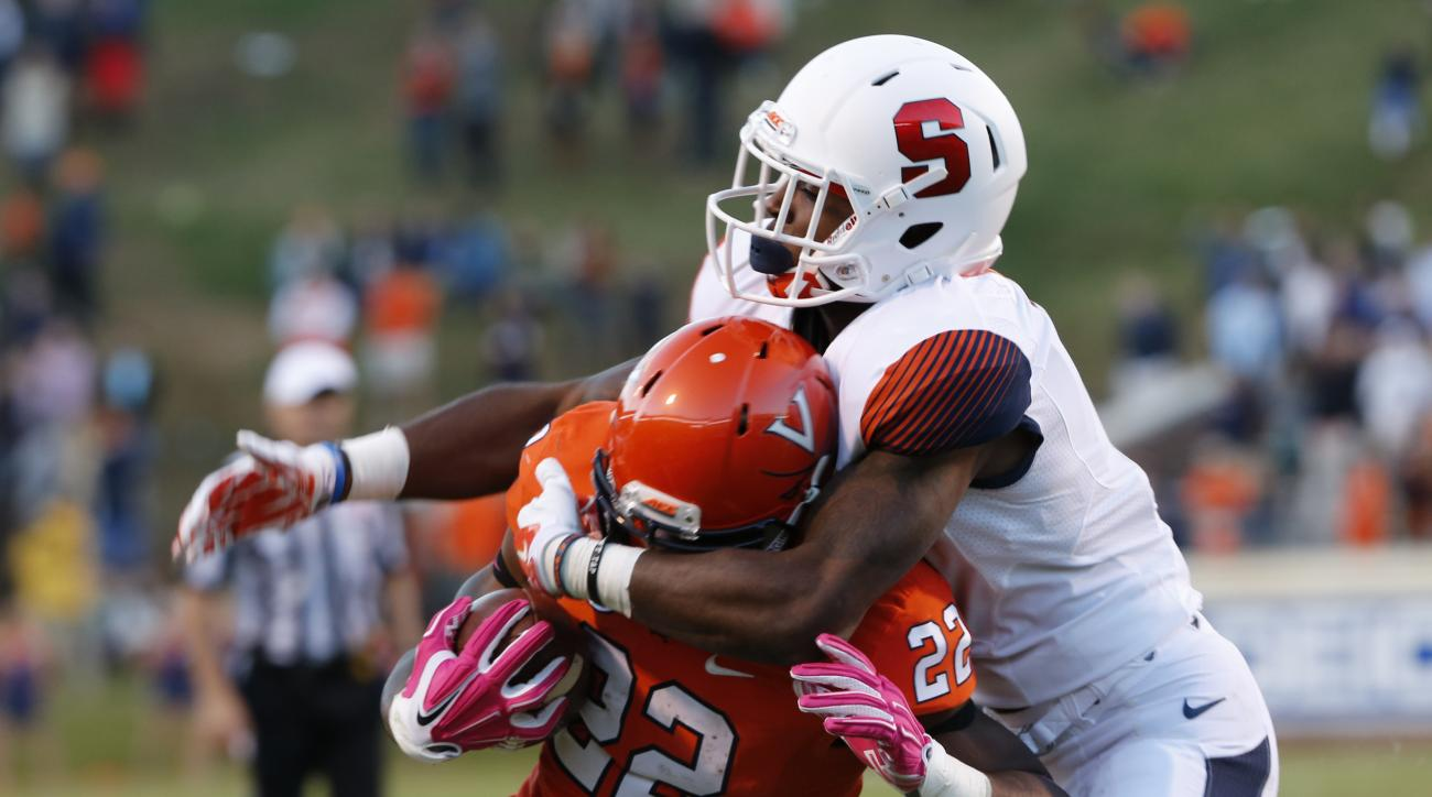 Syracuse cornerback Corey Winfield (11) grabs the face mask of Virginia running back Daniel Hamm (22) during the second half of an NCAA college football game at Scott Stadium in Charlottesville, Va., Saturday, Oct. 17, 2015.  Virginia won the game 44-38 i