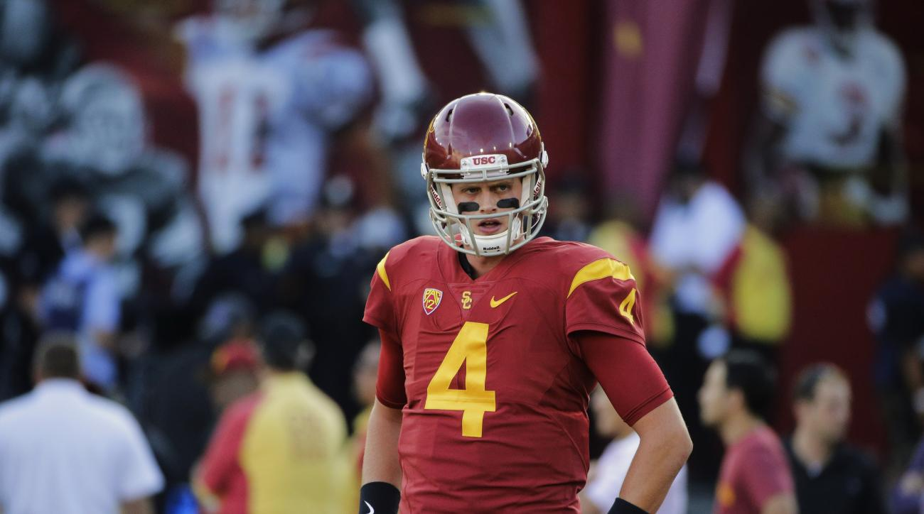 In this Oct. 8, 2015 photo, Southern California quarterback Max Browne warms up before an NCAA college football game against Washington in Los Angeles. Southern California's quarterback competition will continue in fall training camp after coach Clay Helt