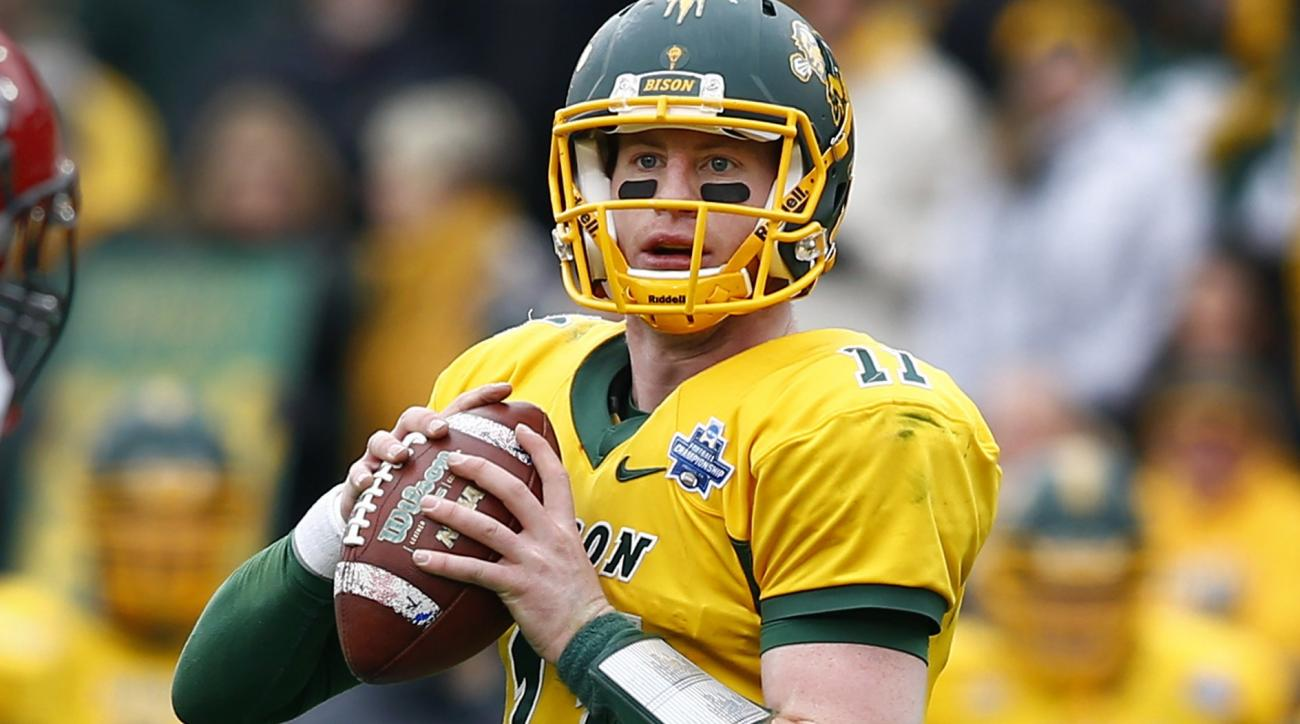 North Dakota State quarterback Carson Wentz (11) performs during the FCS championship NCAA college football game between North Dakota State and Jacksonville State, Saturday, Jan. 9, 2016, in Frisco, Texas.  North Dakota State beat Jacksonville State 37-10