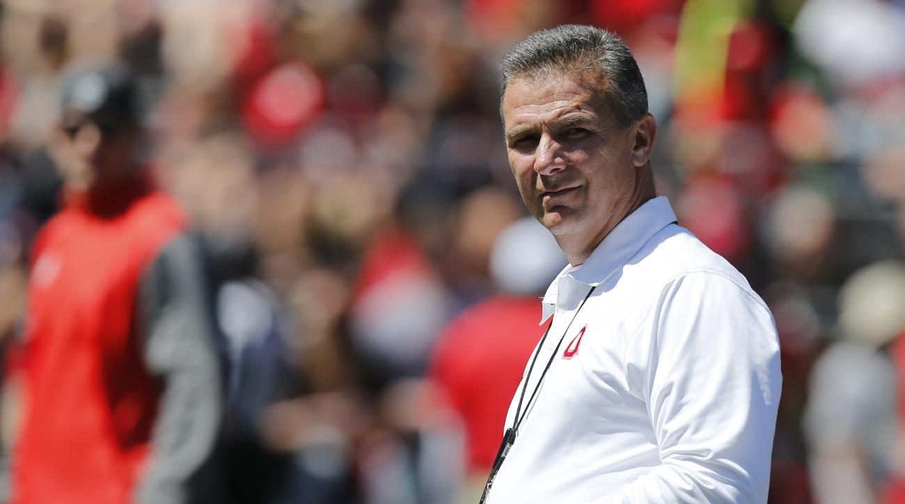FILE - In this Saturday, April 16, 2016 file photo, Ohio State head coach Urban Meyer instructs his team during Ohio State's NCAA college football spring game in Columbus, Ohio. Ohio State just wrapped up its 15 spring practices with the spring game, and