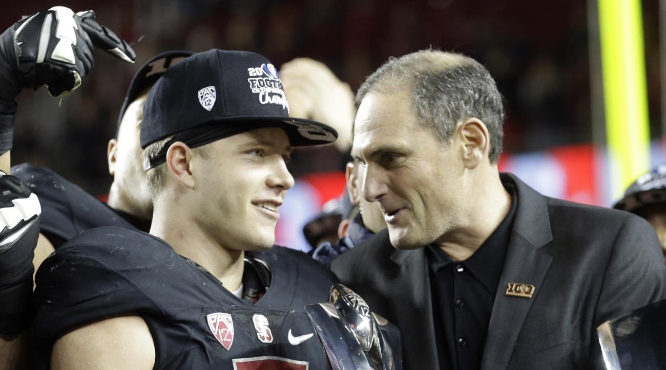 Pac-12 commissioner Larry Scott, right, presents the MVP trophy to Stanford's Christian McCaffrey (5) after Stanford defeated Southern California Saturday, Dec. 5, 2015, in Santa Clara, Calif. (AP Photo/Ben Margot)