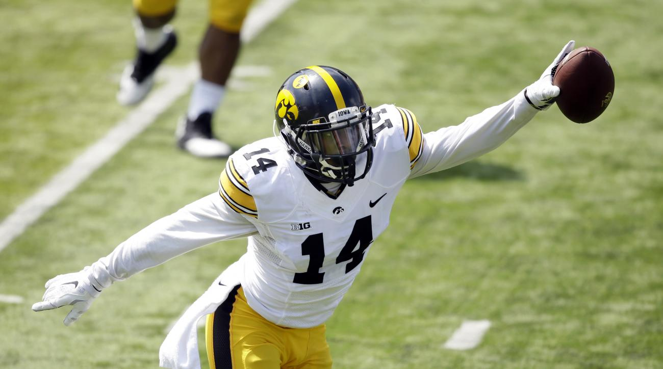 Iowa cornerback Desmond King reacts after intercepting a pass during the team's NCAA college football spring game, Saturday, April 23, 2016, in Iowa City, Iowa. (AP Photo/Charlie Neibergall)