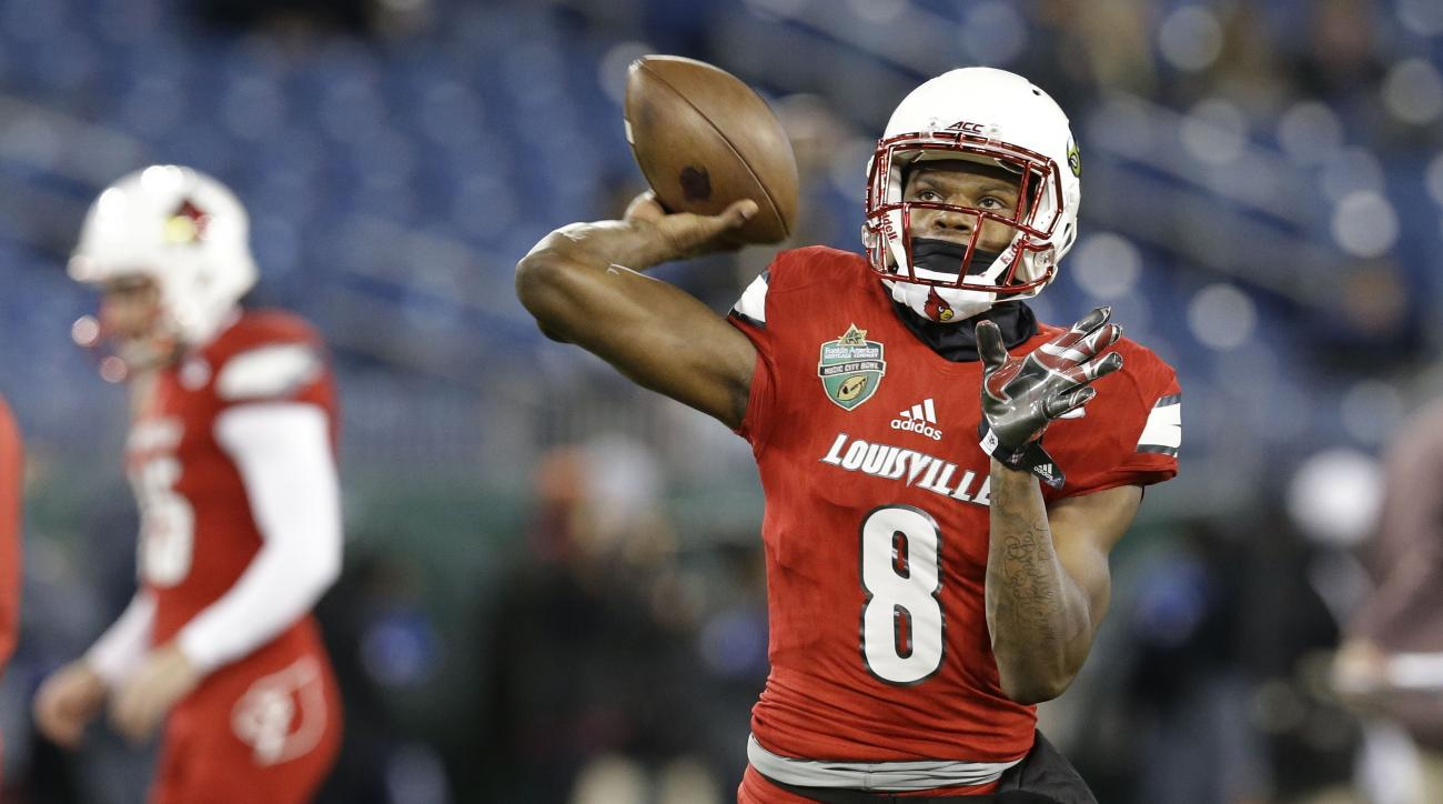 FILE - In this Dec. 30, 2015 file photo, Louisville quarterback Lamar Jackson (8) warms up before the Music City Bowl NCAA college football game against Texas A&M, in Nashville, Tenn. Some teams in the ACCs Atlantic Division kept their offenses humming th
