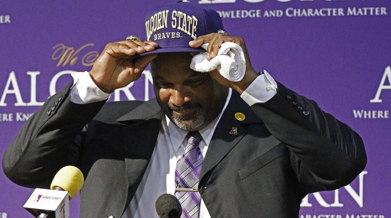 Alcorn State football coach Fred McNair adjusts his baseball cap after being presented to fans and alumni as the new head football coach in Jackson, Miss., Tuesday, Feb. 2, 2016. McNair was the interim head coach, replacing Jay Hopson who was hired as Sou