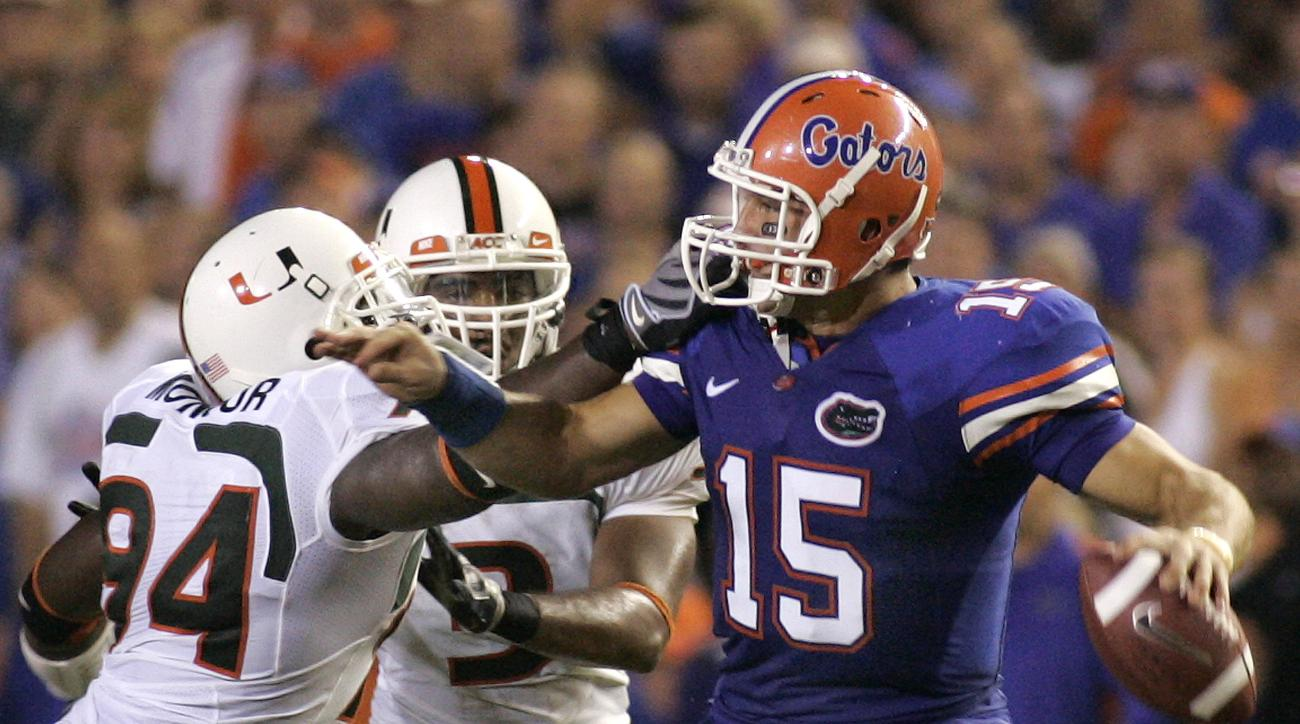 Florida Gators QB Tim Tebow is pressured by Miami Hurricanes Eric Moncur #94 during an NCAA football game between Florida and Miami in Gainesville, Fla., Saturday, Sept. 6, 2008. (AP Photo/Reinhold Matay)