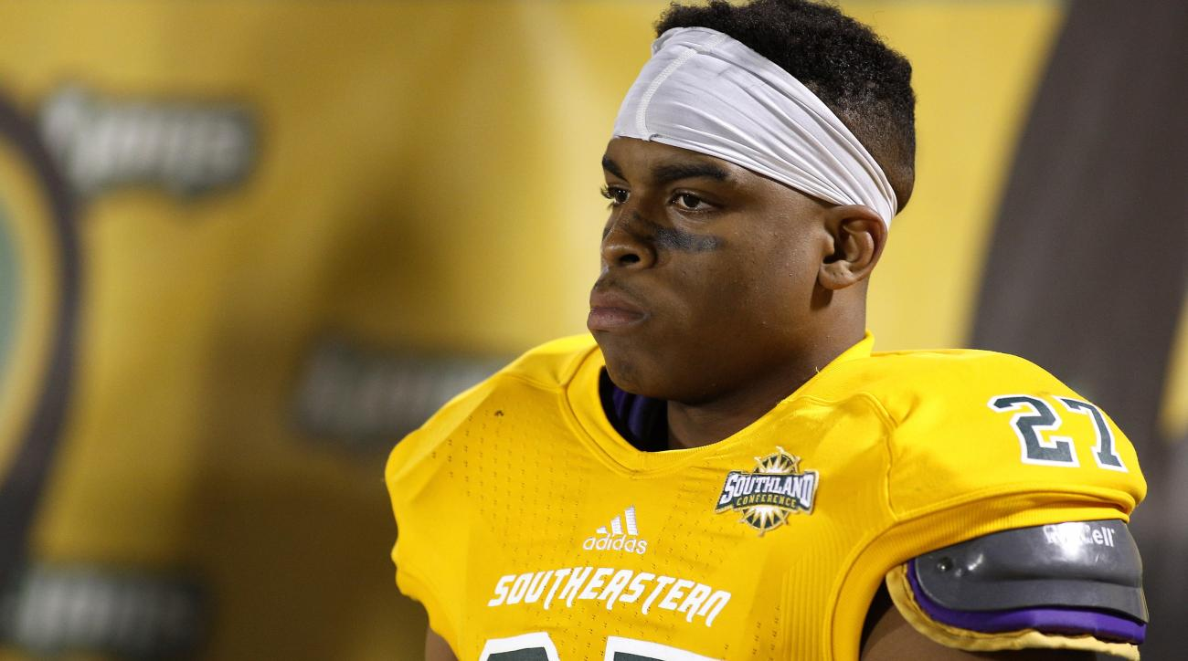 Southeastern Louisiana defensive back Harlan Miller (27) reacts during the second half of an NCAA college football Division 1 championship quarterfinal game against New Hampshire in Hammond, La., Saturday, Dec. 14, 2013. New Hampshire won 20-17. (AP Photo