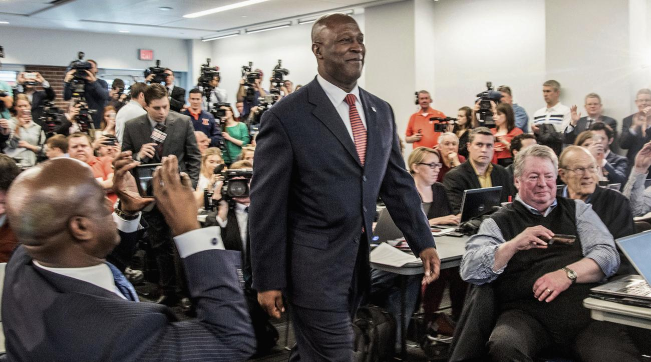 FILE - In this March 7, 2016 file photo, Illinois new football coach, Lovie Smith, is introduced at a news conference in Champaign, Ill. When he took over the Chicago Bears and again this spring when Illinois hired him, Lovie Smith broke new ground that c
