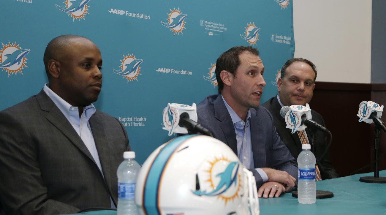 Miami Dolphins general manager Chris Grier, left, head coach Adam Gase, center, and Mike Tannenbaum, executive vice president of football operations, right, talk about the Dolphins' top draft pick Laremy Tunsil at a news conference, Friday, April 29, 2016