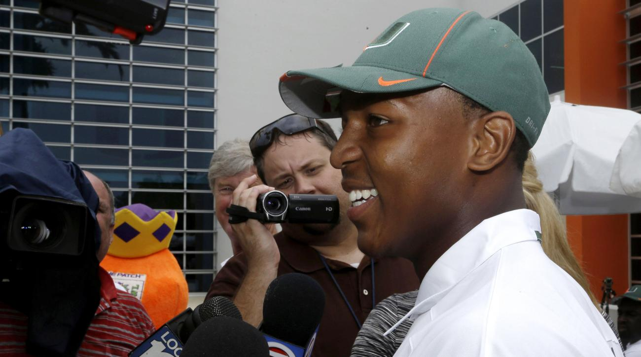 Ray Lewis III talks with the news media during an NCAA football media day, Friday, Aug. 9, 2013, in Coral Gables, Fla. Lewis is the son of retired Baltimore Ravens linebacker Ray Lewis, who also attended Miami. He says its more of a blessing than a burden