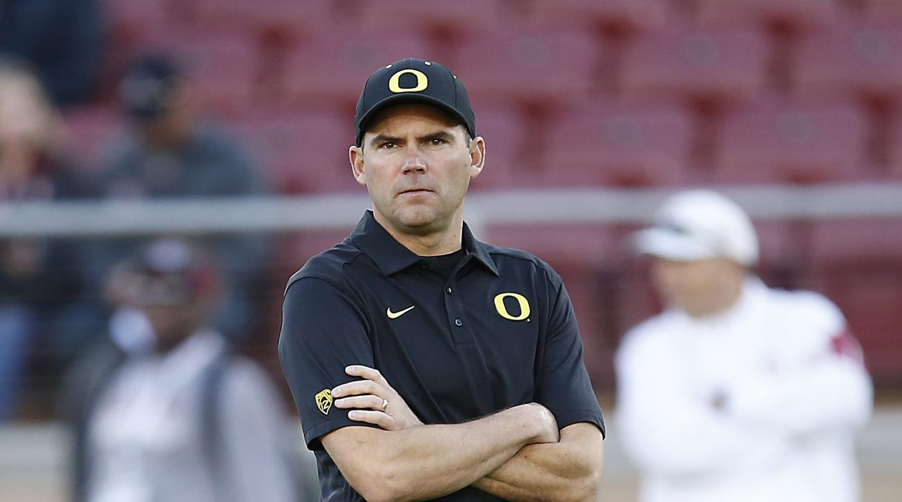 Oregon head coach Mark Helfrich watches warm ups before an NCAA college football game against Stanford on Saturday, Nov. 14, 2015, in Stanford, Calif.  (AP Photo/Tony Avelar)