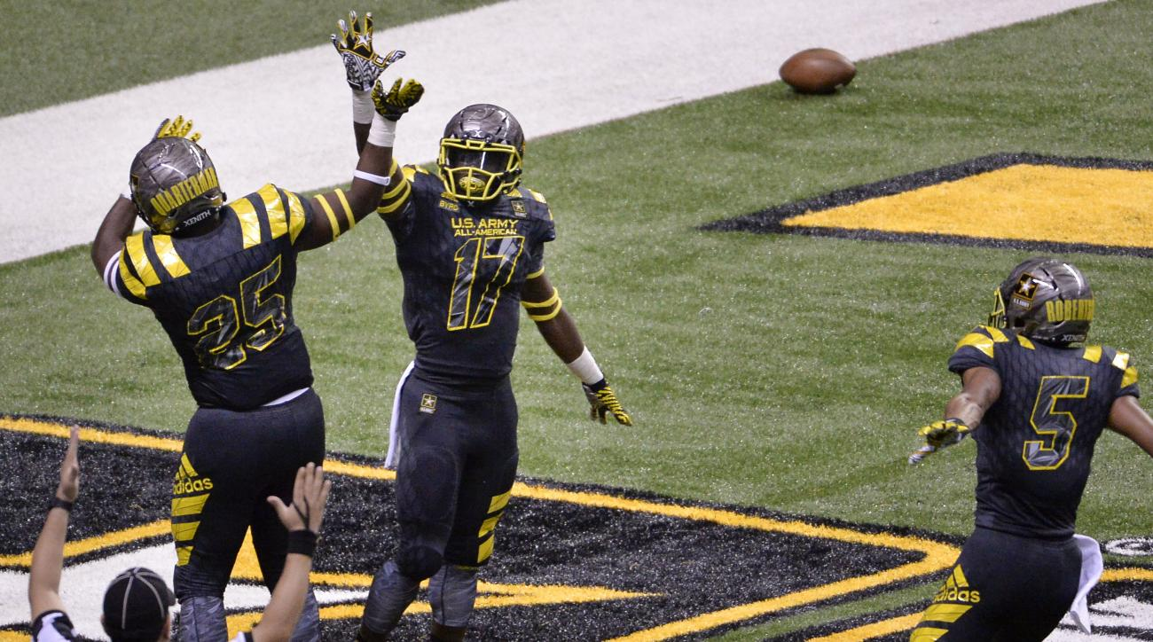 East's Tyler Byrd (17) celebrates a touchdown with teammates Shaquille Quarterman (25) and Demetris Robertson during the first half of the Army All American Bowl high school football game against the West, Saturday, Jan. 9, 2016, in San Antonio. (AP Photo
